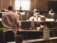 Chefs at work in a restaurant kitchen.