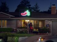 A Chili's employee delivers food to a customer's house.