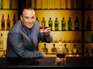 Jon Taffer holding a drink