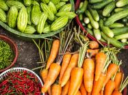 Carrots, cucumbers and other vegetables on display.