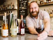 Roofers Union's Wine Director Chas Jefferson holding a glass of wine