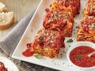 Lasagna on dishes from Carrabba's Italian Grill.