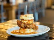 Chicken biscuit on a plate from Maple Street restaurant.