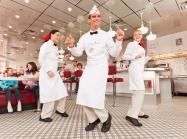 Johnny Rockets employees dance.
