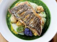 Scratch-made ingredients are found throughout the menu at Loring place, including an herb oil and vinaigrette in the Pan-roasted Sea Bass.
