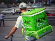 Food delivery driver with an Ubereats backpack.