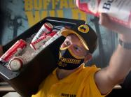 Buffalo Wild Wings' vendor carrying beer.