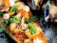 At Sobre Mesa, Saltspring mussels are served atop toast with chipotle escabeche and avocado mousse.