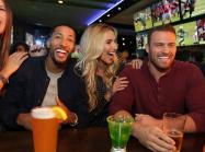 Dave & Buster's customers watching a game at the sports bar.