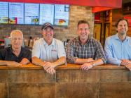 Left to right,Hugh Carroll, president of Global Development for Texas Roadhouse; Jerry Morgan CEO and president of Texas Roadhouse; Adam Saxton, co-CEO and owner of The Saxton Group; and Matt Saxton, co-CEO and owner of The Saxton Group.