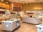 Golden Corral's new-look buffet area, which appears like a residential kitchen with tiled walls and food displayed on buffet bars specifically designed to merchandise Golden Corral favorites.
