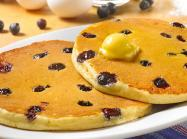 Two blueberry pancakes close up at Huddle House.