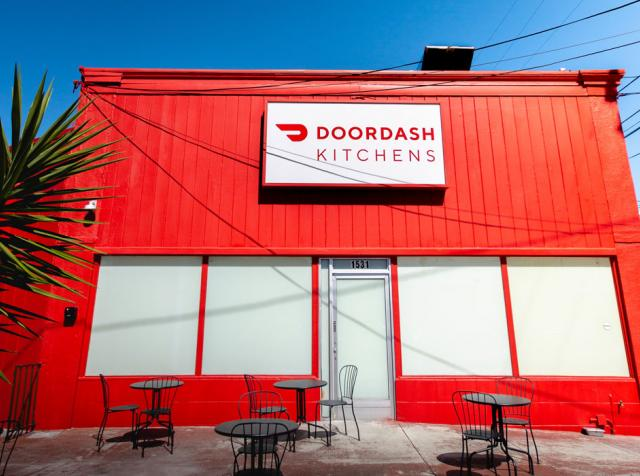 The red exterior of DoorDash Kitchens in California.