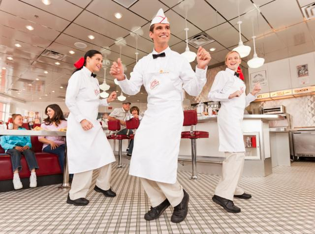 Johnny Rockets employees dance.