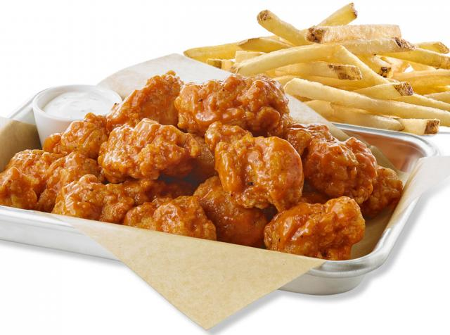 Buffalo Wild Wings boneless wings and fries.