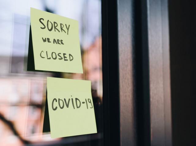Closed sign on a window due to COVID-19.
