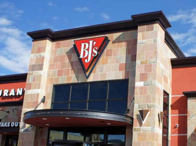 BJ's Restaurants sign outside a restaurant.