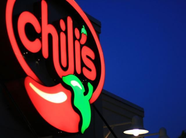 Chili's iconic logo against a night sky. The chain cut its menu down 40 percent.