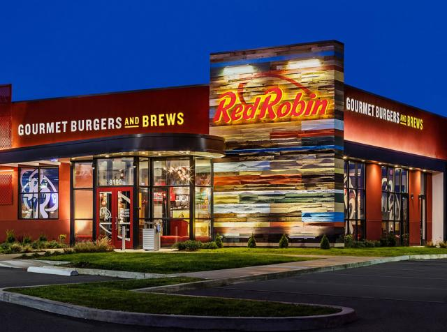 The exterior of a Red Robin restaurant at night.