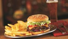 Red Robin's Gourmet Cheeseburger features a fresh, never frozen beef patty fire-grilled to juicy perfection and topped with Red's pickle relish, red onions, pickles, lettuce, tomatoes, mayo and choice of cheese.