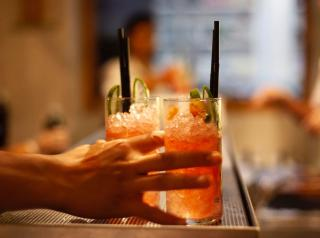 Refreshing drinks prepared by a mixologist and served in an upscale restaurant.