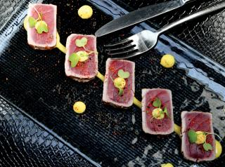 true to his own eclectic background, chef Eom Kyoo pulls flavors and techniques from around the world in dishes such as the Tuna Tataki