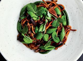 Chef Sinsay puts a pacific Northwest twist on Pancit by incorporating local produce like black garlic, snap peas, and foraged mushrooms.