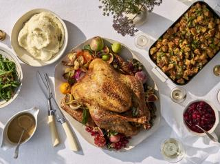A roast turkey and sides on a table.