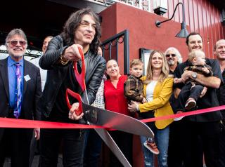 Rock & Brews' founder Paul Stanley, of KISS, cuts the ribbon on a new location.