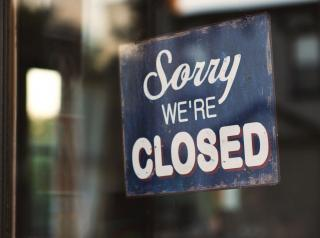 Closed sign hangs in window of shop.
