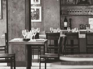 Black and white image of the interior of an empty restaurant.