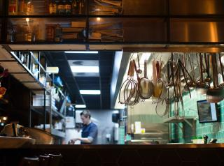 A restaurant kitchen, dimly lit.