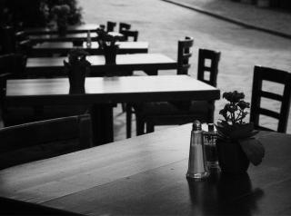 Empty restaurant black and white image.