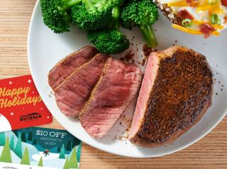 Outback Steakhouse steak and gift cards on a plate.
