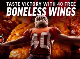 Applebee's free wings poster with football player.