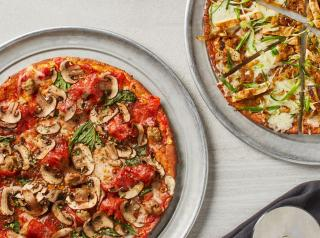 Two pizzas shown using California Pizza Kitchen's Cauliflower Pizza Crust, which is made with high-quality, gluten-free ingredients.