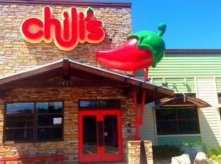 Chili's logo and restaurant are shown in the background. The company is now offering free education to employees.