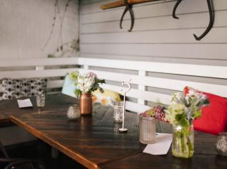 A long wooden table highlights the back patio at California restaurant Restauration.