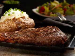Steak and sides at Sizzler restaurant.