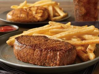 A steak on a plate at Outback.