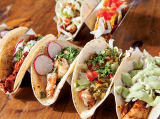 A row of tacos at Tacos & Tequila Cantina.