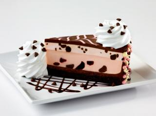 The new Very Cherry Ghirardelli Chocolate Cheesecake is a cherry cheesecake on a layer of fudge cake, loaded with cherries and Ghirardelli chocolate.