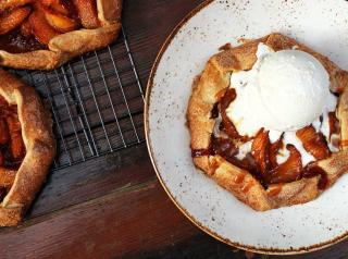 Peach Raspberry Hand Pie: made from scratch raspberry puree, sweet peaches, cinnamon and sugar, salted caramel sauce, served warm with a scoop of vanilla bean ice cream.