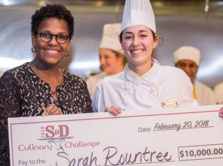 Johnson & Wales University Charlotte student Sarah Rountree poses with her $10,000 grand prize check in the 8th annual S&D Culinary Challenge.