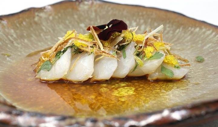 Crudo plate featuring snapper sashimi, citrus caviar, negi oil and ponzu sauce.