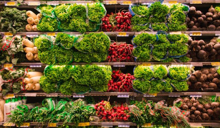 A backdrop of vegetables at a grocery store.