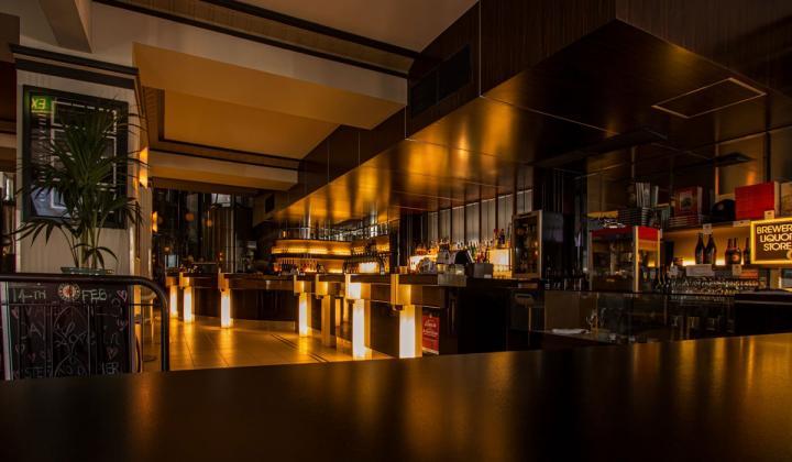 A darkly lit hotel restaurant.