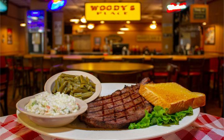 A steak and sides at Woody's Bar-B-Q restaurant.