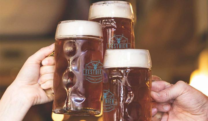 Three mugs full of beer