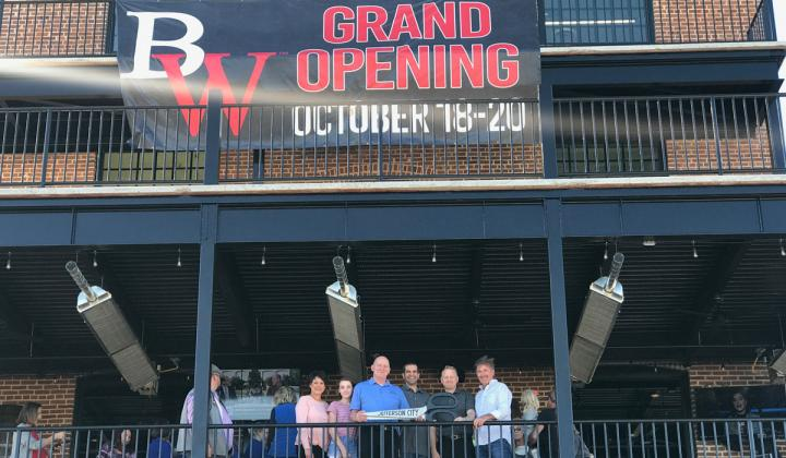 People stand outside the new Big Whiskey's opening.